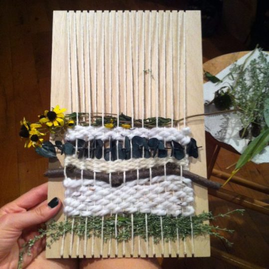 weaving on wood with flowers and fabric